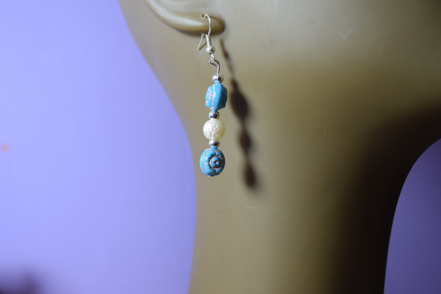 Turquoise shaped flowers with  white peals earrings