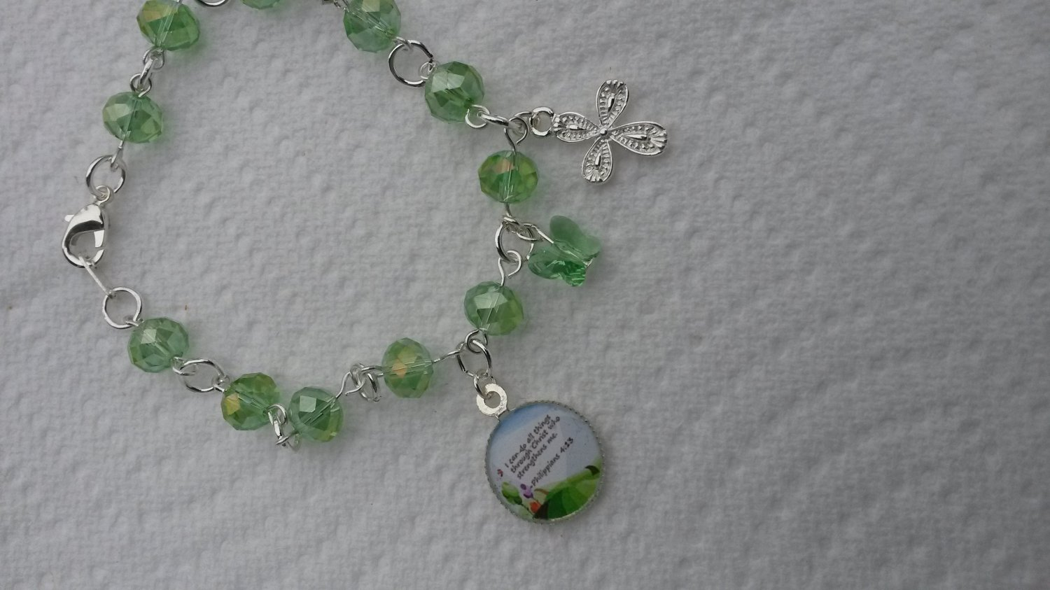 A lovely Bible verse bracelet made with stunning peridot green Czech glass and heavy gauge findings.