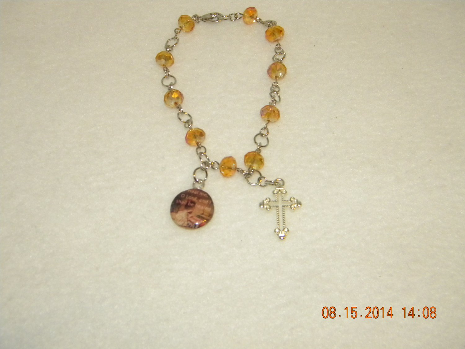 Golden glow charm bracelet w/ Jer.17:14 Bible verse charm and Cross