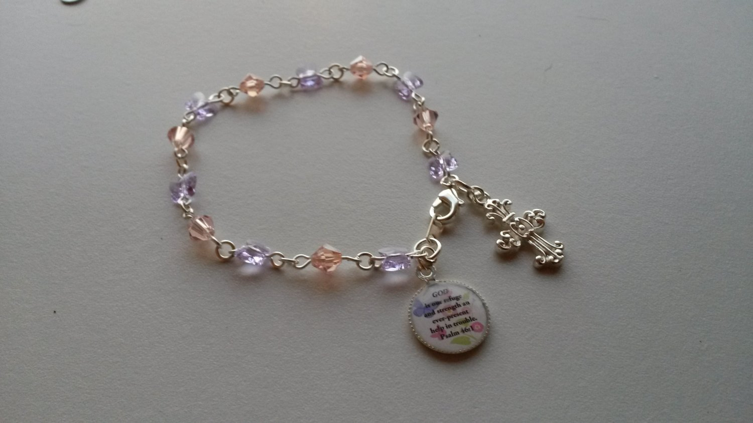 A pretty Swarovski butterflies and crystals bracelet w/Bible verse charm