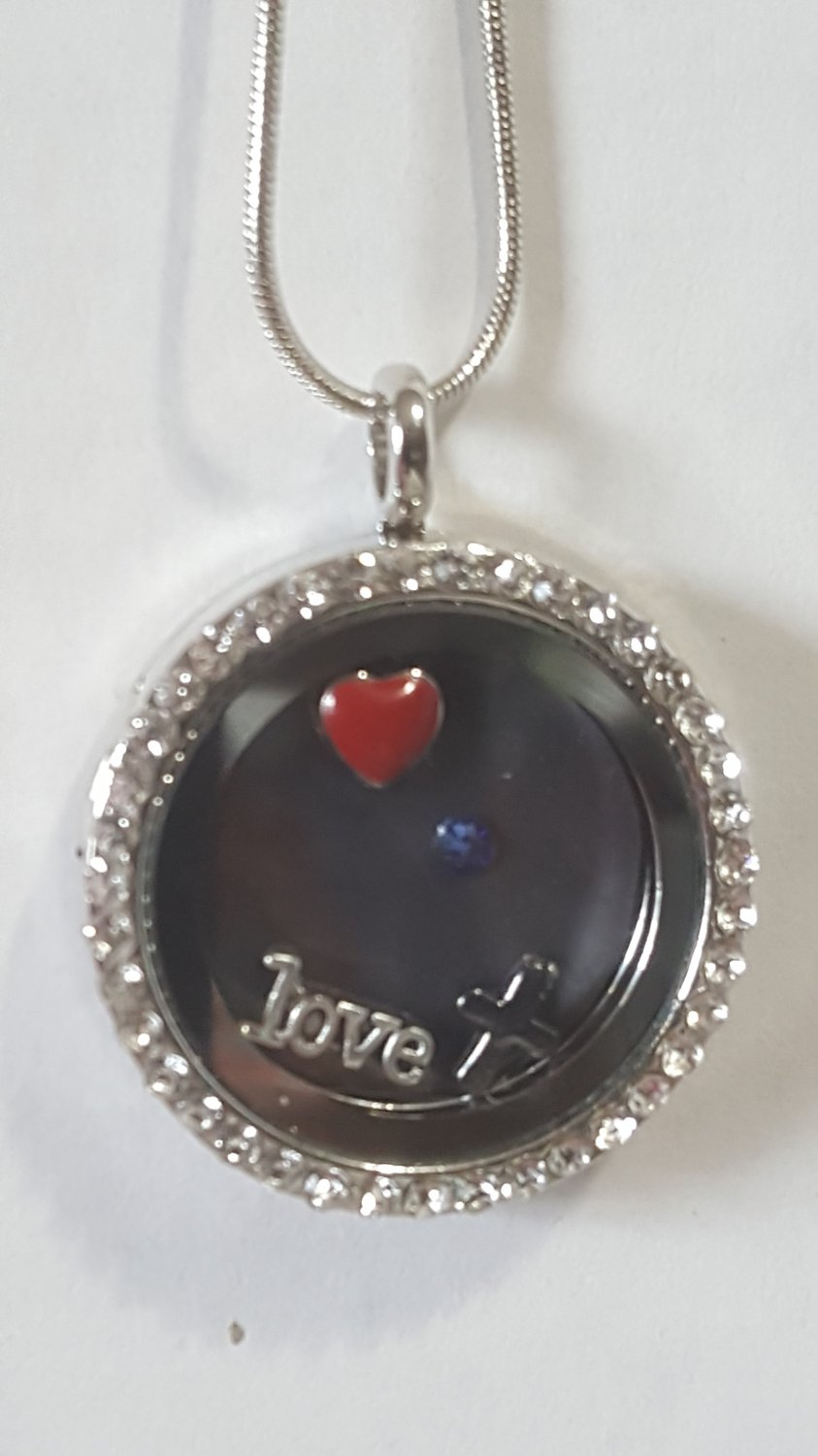 Floating Story Locket with magnetic insert and magnetic charms.