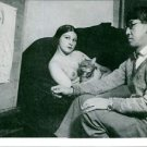 Léonard Tsugouharu Foujita sitting with a woman on sofa. - 8x10 photo