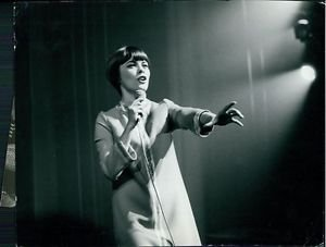 Mireille Mathieu performing. - 8x10 photo