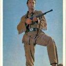 Lex Barker holding gun.  - 8x10 photo