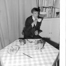 Rudolf Khametovich Nureyev having tea. - 8x10 photo