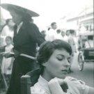 Silvana Mangano sitting on chair.  - 8x10 photo