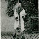 Josephine Baker with her dog. - 8x10 photo