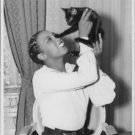 Josephine Baker playing with cat.  - 8x10 photo