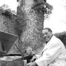 Duke Ellington playing piano and smiling.  - 8x10 photo