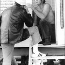 Steve McQueen in a conversation with man.  - 8x10 photo