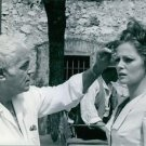 Stanleyl Kramer with Virna Lisi. - 8x10 photo