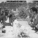 Josephine Baker talking to a man.  - 8x10 photo