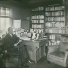 Natanael Beskow sitting in a library. - 8x10 photo