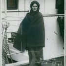 A woman standing on ship, wearing shawl. - 8x10 photo