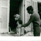Brigitte Bardot hugging with a man.  - 8x10 photo