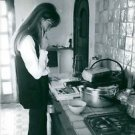 Francoise Madeleine Hardy reading cooking book.  - 8x10 photo