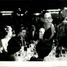 Marliyn Monroe in a party with friends.   - 8x10 photo