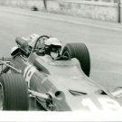 Lorenzo Bandini in car race.  - 8x10 photo