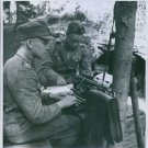 Finnish-Russian War 1941Soldiers typing something on the typewriter, another so