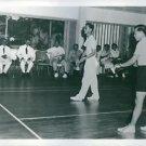 His Majesty King Bhumibol Adulyadej of Thailand play badminton with Mr. Wong Pen