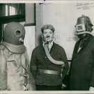 Men wearing protective workwear. 1937 - 8x10 photo