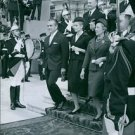 Rainier III and Grace Kelly receiving guard of honor with other people.  - 8x10