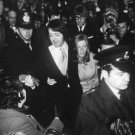 Paul McCartney and Linda Eastman surrounded by people. - 8x10 photo