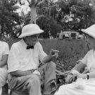 Albert Schweitzer sitting with women. - 8x10 photo