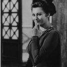 Sophia Loren pointing at nose and smiling. - 8x10 photo