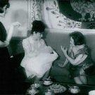 Farah Pahlavi having conversation with two woman.  - 8x10 photo