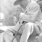 Winston Churchill, British politician picking his nose. - 8x10 photo