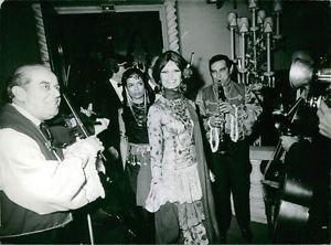 Brigitte Bardot enjoying music.  - 8x10 photo
