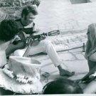 Brigitte Bardot sitting and listening music. - 8x10 photo