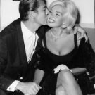 Jayne Mansfield kissed on cheek by husband. - 8x10 photo