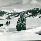 Brigitte Bardot with dog on snow covered land.  - 8x10 photo