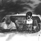 Audrey Hepburn driving a car. - 8x10 photo