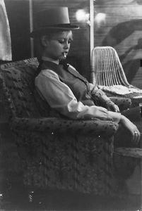 Brigitte Bardot smoking. - 8x10 photo