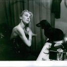 Claude Bessy grooming herself in front of the mirror. - 8x10 photo