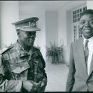 Moise Tshombe standing with a man. - 8x10 photo