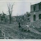 1945German refugees move through ruins of Regensburg. - 8x10 photo