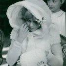 Sylvie Vartan sitting wearing a white gown. - 8x10 photo