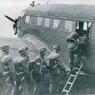 Soldiers getting into military airplane.  - 8x10 photo