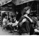 Claudia Cardinale walking by cafe. - 8x10 photo