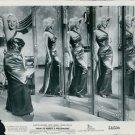 Marilyn Monroe posing at mirror. - 8x10 photo