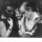 Rudolf Nureyev writing autograph. - 8x10 photo