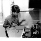 Claudia Cardinale in kitchen. - 8x10 photo