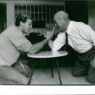 Sean Flynn armwrestling with older man.  - 8x10 photo