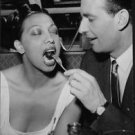 Man feeding Josephine Baker.   - 8x10 photo