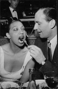 Man feeding Josephine Baker.   - 8x10 photo