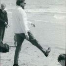 Richard Burton at beach. - 8x10 photo
